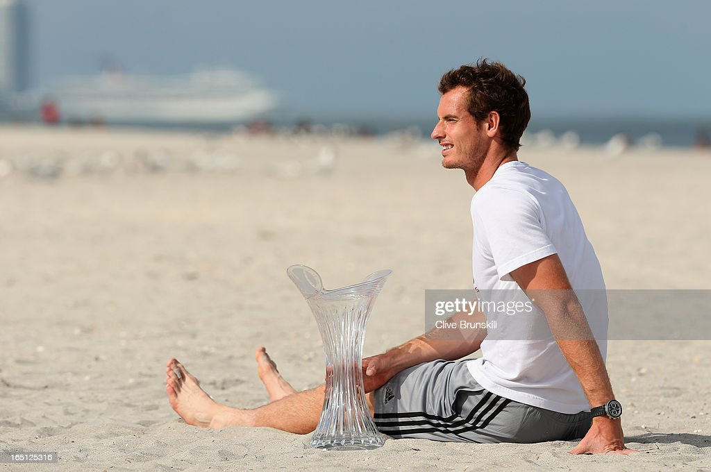 <a gi-track='captionPersonalityLinkClicked' href=/galleries/search?phrase=Andy+Murray+-+Tennis+Player&family=editorial&specificpeople=200668 ng-click='$event.stopPropagation()'>Andy Murray</a> of Great Britain poses for photographs with the trophy on the beach after his three set victory against David Ferrer of Spain during their final match at the Sony Open at Crandon Park Tennis Center on March 31, 2013 in Key Biscayne, Florida.