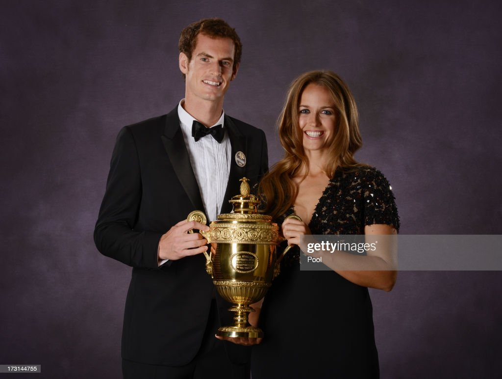 Andy Murray of Great Britain poses his poses with his girlfriend Kim Sears and the Gentlemen's Singles Trophy at the Wimbledon Championships 2013 Winners Ball at InterContinental Park Lane Hotel on July 7, 2013 in London, England.