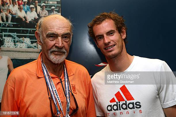 Andy Murray of Great Britain poses with actor Sean Connery after his men's singles semifinal match against Tomas Berdych of Czech Republic on Day...