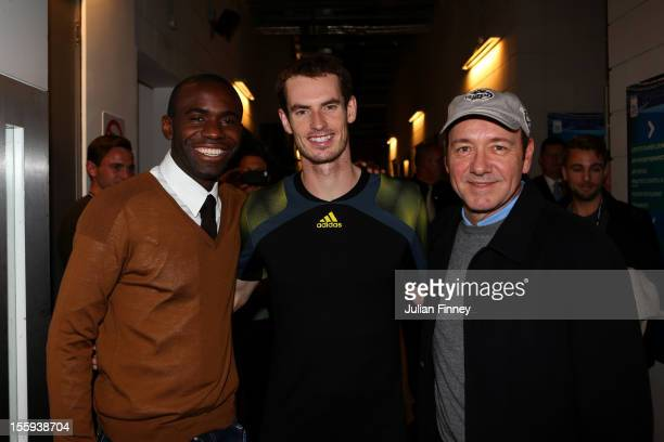 Andy Murray of Great Britain poses with former Premier League footballer Fabrice Muamba and actor Kevin Spacey after his men's singles match against...