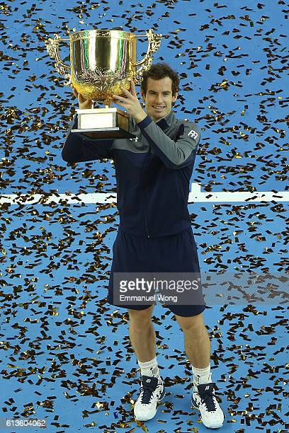 Andy Murray of Great Britain poses with his trophy after winning the the Men's singles final match against Grigor Dimitrov of Bulgaria on day 9 of...