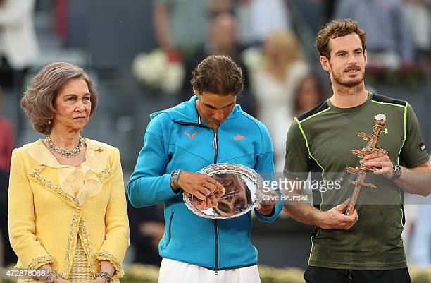 Andy Murray of Great Britain poses with his winners trophy after his straight sets victory against Rafael Nadal of Spain along with Queen Sofia of...