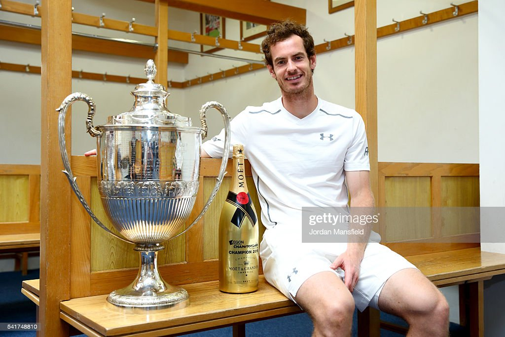Andy Murray of Great Britain poses with the Aegon Championships trophy after winning his record breaking fifth title with victory in his final match against Milos Raonic of Canada during day seven of the Aegon Championships at the Queens Club on June 19, 2016 in London, England.