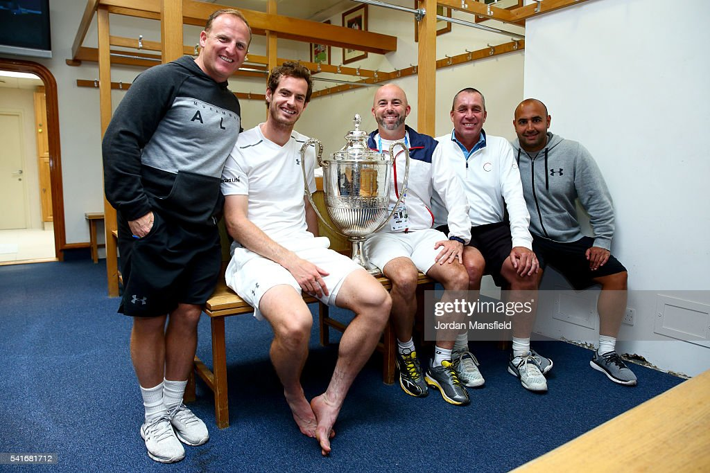 Andy Murray of Great Britain poses with the Aegon Championships trophy with (L-R) fitness coach Matt Little, Jamie Delgado, coach Ivan Lendl and physio Shane Annun, after winning his record breaking fifth title with victory in his final match against Milos Raonic of Canada during day seven of the Aegon Championships at the Queens Club on June 19, 2016 in London, England.
