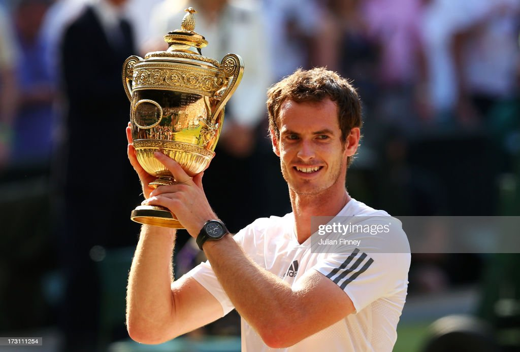 <a gi-track='captionPersonalityLinkClicked' href=/galleries/search?phrase=Andy+Murray+-+Tennis+Player&family=editorial&specificpeople=200668 ng-click='$event.stopPropagation()'>Andy Murray</a> of Great Britain poses with the Gentlemen's Singles Trophy following his victory in the Gentlemen's Singles Final match against Novak Djokovic of Serbia on day thirteen of the Wimbledon Lawn Tennis Championships at the All England Lawn Tennis and Croquet Club on July 7, 2013 in London, England.