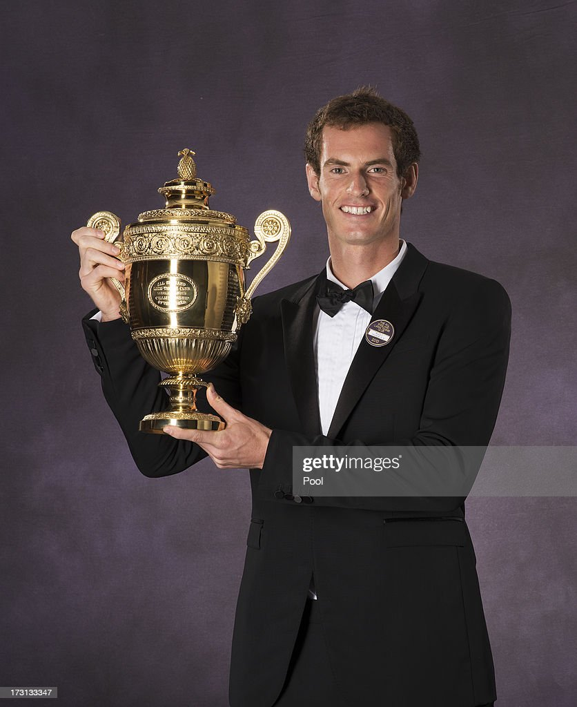 Andy Murray of Great Britain poses with the Gentlemen's Singles Trophy at the Wimbledon Championships 2013 Winners Ball at InterContinental Park Lane Hotel on July 7, 2013 in London, England.