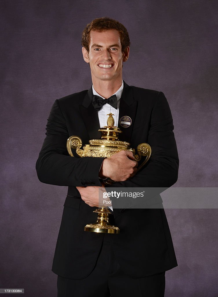 <a gi-track='captionPersonalityLinkClicked' href=/galleries/search?phrase=Andy+Murray+-+Tennis+Player&family=editorial&specificpeople=200668 ng-click='$event.stopPropagation()'>Andy Murray</a> of Great Britain poses with the Gentlemen's Singles Trophy at the Wimbledon Championships 2013 Winners Ball at InterContinental Park Lane Hotel on July 7, 2013 in London, England.