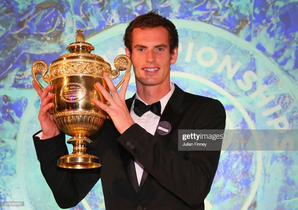 Andy Murray of Great Britain poses with the Gentlemen's Singles Trophy during the Wimbledon Championships 2013 Winners Ball at InterContinental Park Lane Hotel on July 7, 2013 in London, England.