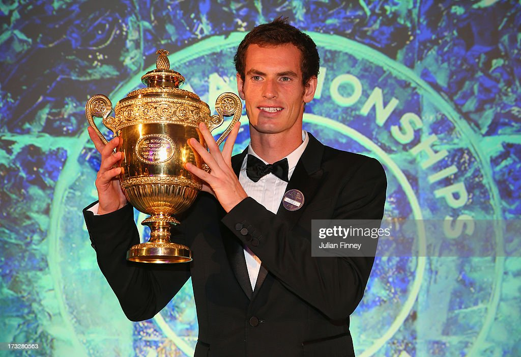 <a gi-track='captionPersonalityLinkClicked' href=/galleries/search?phrase=Andy+Murray+-+Tennis+Player&family=editorial&specificpeople=200668 ng-click='$event.stopPropagation()'>Andy Murray</a> of Great Britain poses with the Gentlemen's Singles Trophy during the Wimbledon Championships 2013 Winners Ball at InterContinental Park Lane Hotel on July 7, 2013 in London, England.
