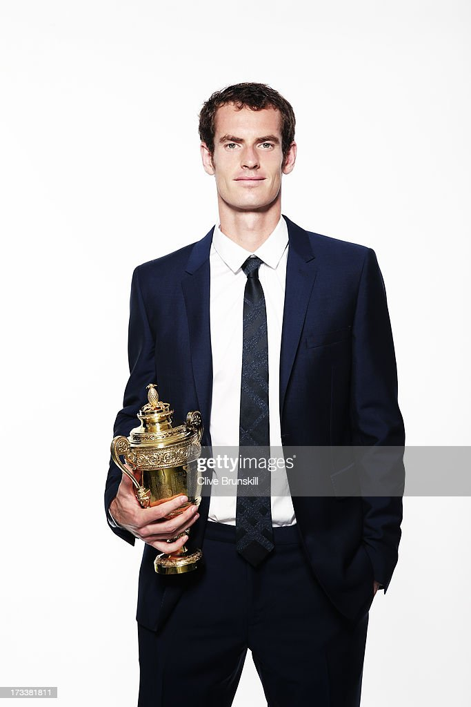 This image has been retouched) (PREMIUM PRICING APPLIES - MINIMUM PRINT FEE OF GBP 250, ONLINE FEE OF GBP 75 USE OR LOCAL EQUIVALENTS) Andy Murray of Great Britain poses with the Gentlemen's Singles Trophy during an exclusive photo shoot following his victory in the Wimbledon Championships Gentlemen's Singles final match against Novak Djokovic of Serbia on July 8, 2013 in London, England.