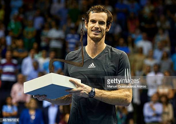 Andy Murray of Great Britain poses with the trophy after his men's singles final match against Tommy Robredo of Spain during day seven of the ATP 500...