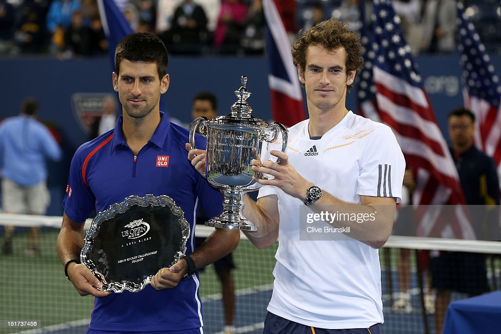 <a gi-track='captionPersonalityLinkClicked' href=/galleries/search?phrase=Andy+Murray+-+Jogador+de+t%C3%A9nis&family=editorial&specificpeople=200668 ng-click='$event.stopPropagation()'>Andy Murray</a> of Great Britain poses with the US Open championship trophy next to <a gi-track='captionPersonalityLinkClicked' href=/galleries/search?phrase=Novak+Djokovic&family=editorial&specificpeople=588315 ng-click='$event.stopPropagation()'>Novak Djokovic</a> of Serbia after his victory in the men's singles final match on Day Fifteen of the 2012 US Open at USTA Billie Jean King National Tennis Center on September 10, 2012 in the Flushing neighborhood of the Queens borough of New York City. Murray defeated Djokovic 7-6, 7-5, 2-6, 3-6, 6-2.