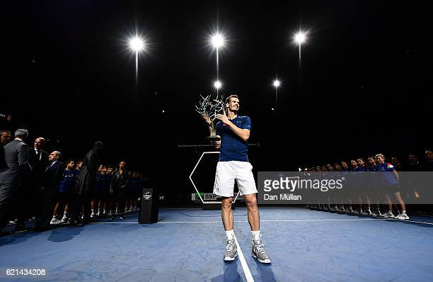 Andy Murray of Great Britain poses with 'Tree of Fanti' Trophy after winning the Mens Singles Final against John Isner of the United States on day...