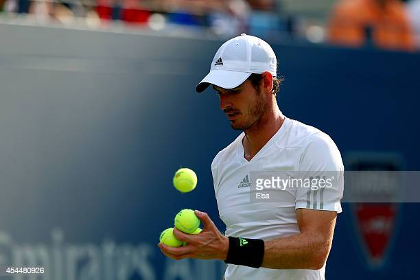 Andy Murray of Great Britain prepares to serve serves against JoWilfried Tsonga of France during their men's singles fourth round match on Day Eight...