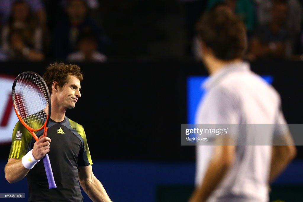 Andy Murray of Great Britain questions a line call in his semifinal match against Roger Federer of Switzerland during day twelve of the 2013 Australian Open at Melbourne Park on January 25, 2013 in Melbourne, Australia.