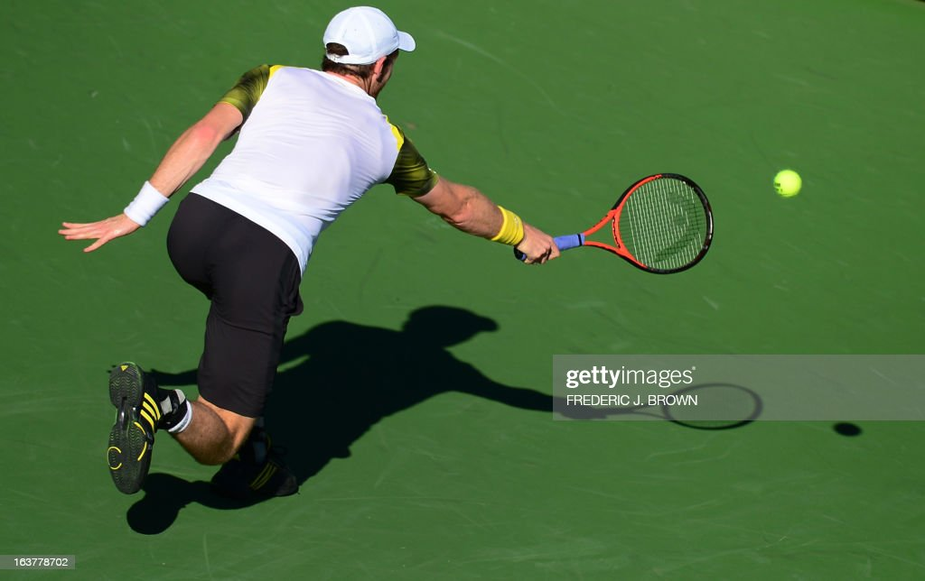 Andy Murray of Great Britain reaches for a backhand return against Juan Martin del Potro of Argentina on March 15, 2013 in Indian Wells, California, during their quarterfinal match at the BNP Paribas Open. AFP PHOTO/Frederic J. BROWN