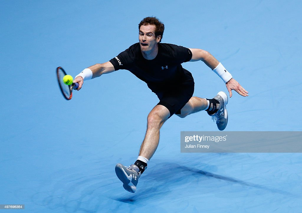 Andy Murray of Great Britain reaches for a forehand in his men's singles match against Rafael Nadal of Spain during day four of the Barclays ATP...
