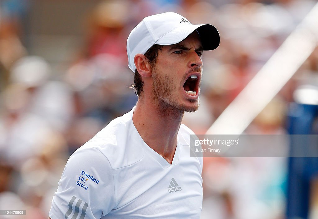 <a gi-track='captionPersonalityLinkClicked' href=/galleries/search?phrase=Andy+Murray+-+Tennisspelare&family=editorial&specificpeople=200668 ng-click='$event.stopPropagation()'>Andy Murray</a> of Great Britain reacts after winning a point against Jo-Wilfried Tsonga of France during their men's singles fourth round match on Day Eight of the 2014 US Open at the USTA Billie Jean King National Tennis Center on September 1, 2014 in the Flushing neighborhood of the Queens borough of New York City.