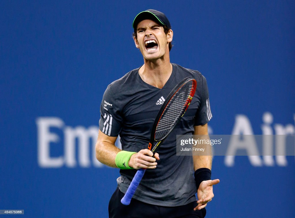<a gi-track='captionPersonalityLinkClicked' href=/galleries/search?phrase=Andy+Murray+-+Tennis+Player&family=editorial&specificpeople=200668 ng-click='$event.stopPropagation()'>Andy Murray</a> of Great Britain reacts against Novak Djokovic of Serbia during their men's singles quarterfinal match on Day Ten of the 2014 US Open at the USTA Billie Jean King National Tennis Center on September 3, 2014 in the Flushing neighborhood of the Queens borough of New York City.