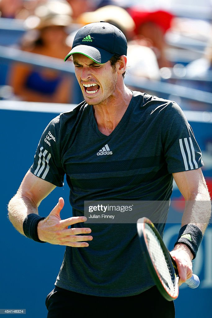 <a gi-track='captionPersonalityLinkClicked' href=/galleries/search?phrase=Andy+Murray+-+Tennis+Player&family=editorial&specificpeople=200668 ng-click='$event.stopPropagation()'>Andy Murray</a> of Great Britain reacts against Robin Haase of the Netherlands during his men's singles first round match on Day One of the 2014 US Open at the USTA Billie Jean King National Tennis Center on August 25, 2014 in the Flushing neighborhood of the Queens borough of New York City.