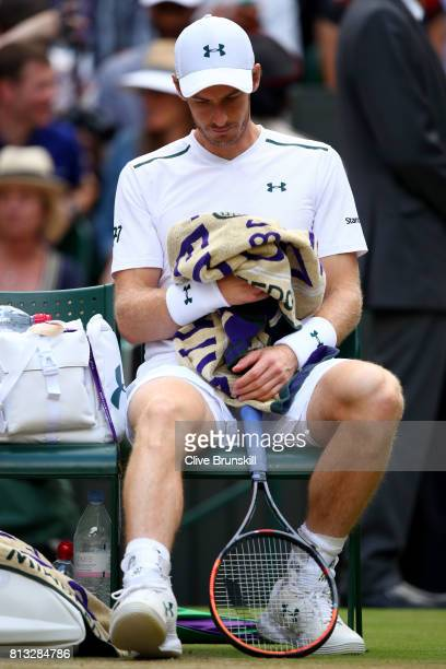 Andy Murray of Great Britain reacts as he takes a break during the Gentlemen's Singles quarter final match against Sam Querrey of The United States...