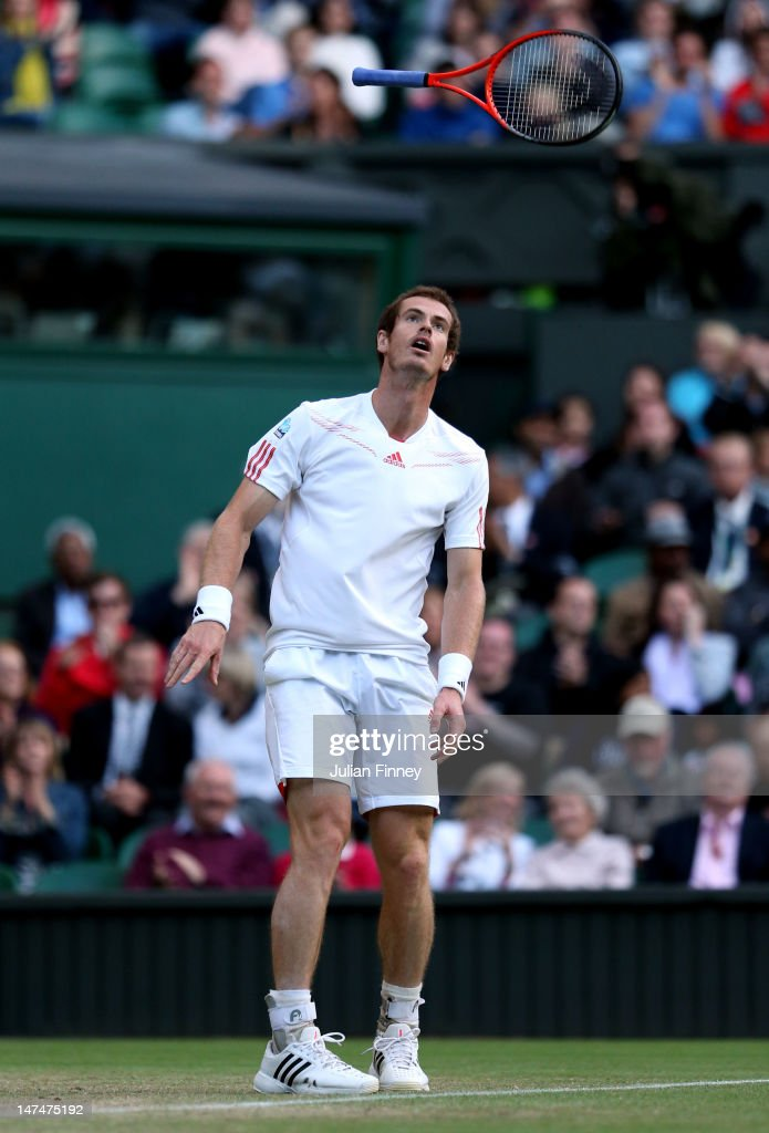 <a gi-track='captionPersonalityLinkClicked' href=/galleries/search?phrase=Andy+Murray+-+Tennis+Player&family=editorial&specificpeople=200668 ng-click='$event.stopPropagation()'>Andy Murray</a> of Great Britain reacts during his Gentlemen's Singles third round match against Marcos Baghdatis of Cyprus on day six of the Wimbledon Lawn Tennis Championships at the All England Lawn Tennis and Croquet Club at Wimbledon on June 30, 2012 in London, England.