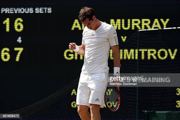 Andy Murray of Great Britain reacts during his Gentlemen's Singles quarterfinal match against Grigor Dimitrov of Bulgaria on day nine of the...