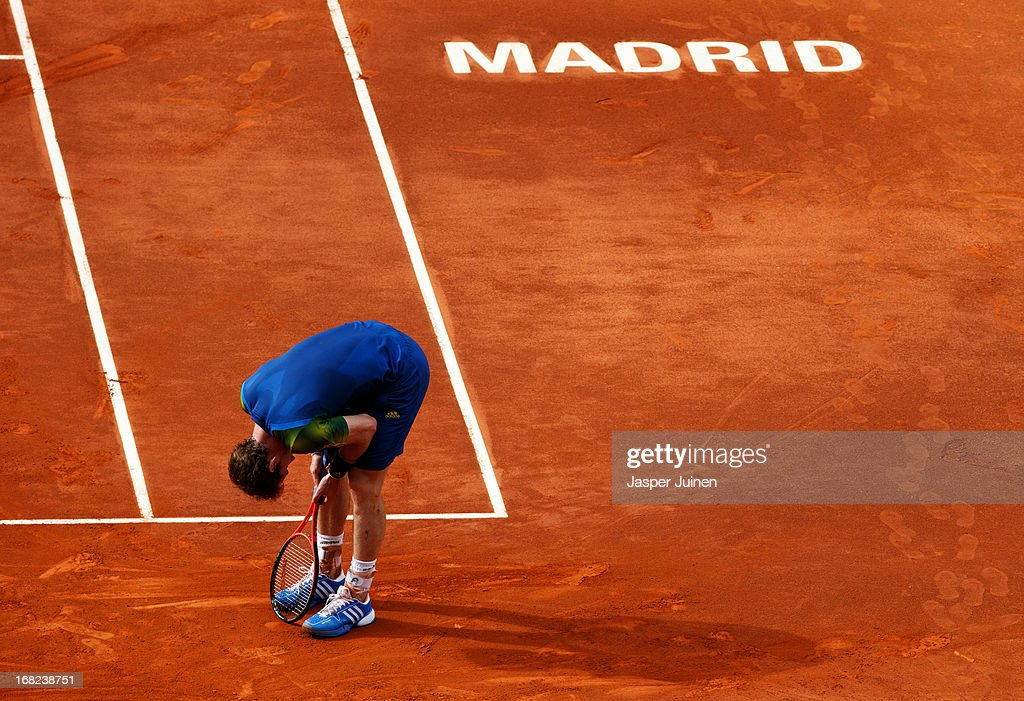<a gi-track='captionPersonalityLinkClicked' href=/galleries/search?phrase=Andy+Murray+-+Tennis+Player&family=editorial&specificpeople=200668 ng-click='$event.stopPropagation()'>Andy Murray</a> of Great Britain reacts during his match against Florian Mayer of Germany on day four of the Mutua Madrid Open tennis tournament at the Caja Magica on May 7, 2013 in Madrid, Spain.
