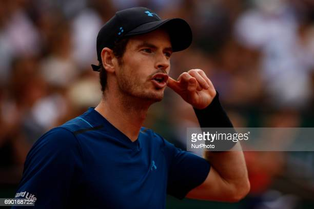 Andy Murray of Great Britain reacts during the first round match against Andrey Kuznetsov of Russia on day three of the 2017 French Open at Roland...