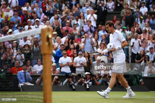 Andy Murray of Great Britain reacts in defeat after the Gentlemen's Singles quarter final match against Sam Querrey of The United States on day nine...