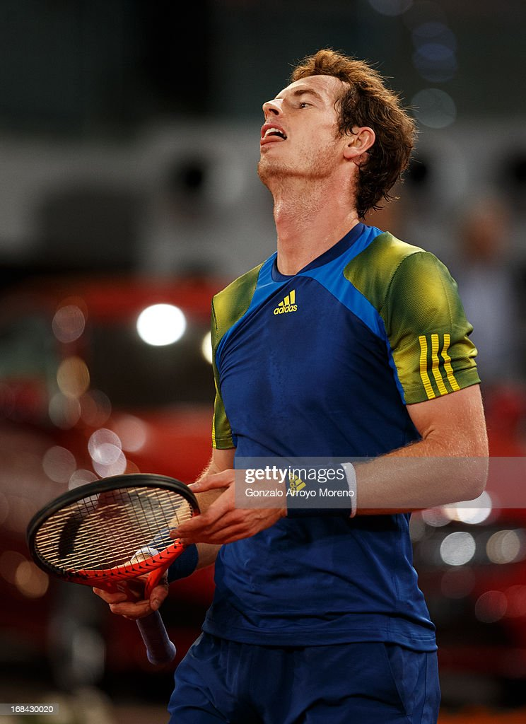 <a gi-track='captionPersonalityLinkClicked' href=/galleries/search?phrase=Andy+Murray+-+Tennis+Player&family=editorial&specificpeople=200668 ng-click='$event.stopPropagation()'>Andy Murray</a> of Great Britain reacts in his match against Gilles Simon of France on day six of the Mutua Madrid Open tennis tournament at the Caja Magica on May 9, 2013 in Madrid, Spain.