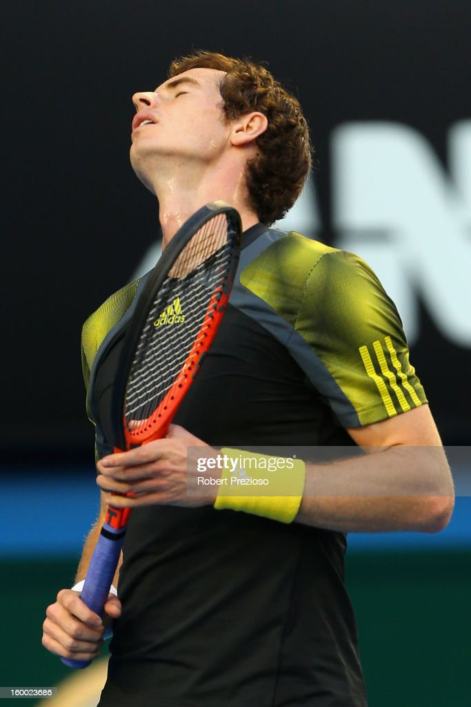 Andy Murray of Great Britain reacts to a point in his semifinal match against Roger Federer of Switzerland during day twelve of the 2013 Australian Open at Melbourne Park on January 25, 2013 in Melbourne, Australia.