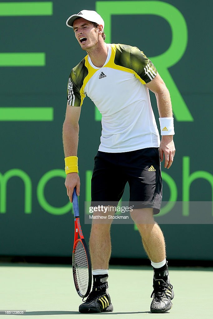 Andy Murray of Great Britain reacts to pain after losing a point to David Ferrer of Spain during the final of the Sony Open at Crandon Park Tennis Center on March 31, 2013 in Key Biscayne, Florida.