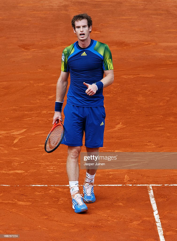 Andy Murray of Great Britain reacts with his thumb up to a referee decision during his match against Florian Mayer of Germany on day four of the Mutua Madrid Open tennis tournament at the Caja Magica on May 7, 2013 in Madrid, Spain.