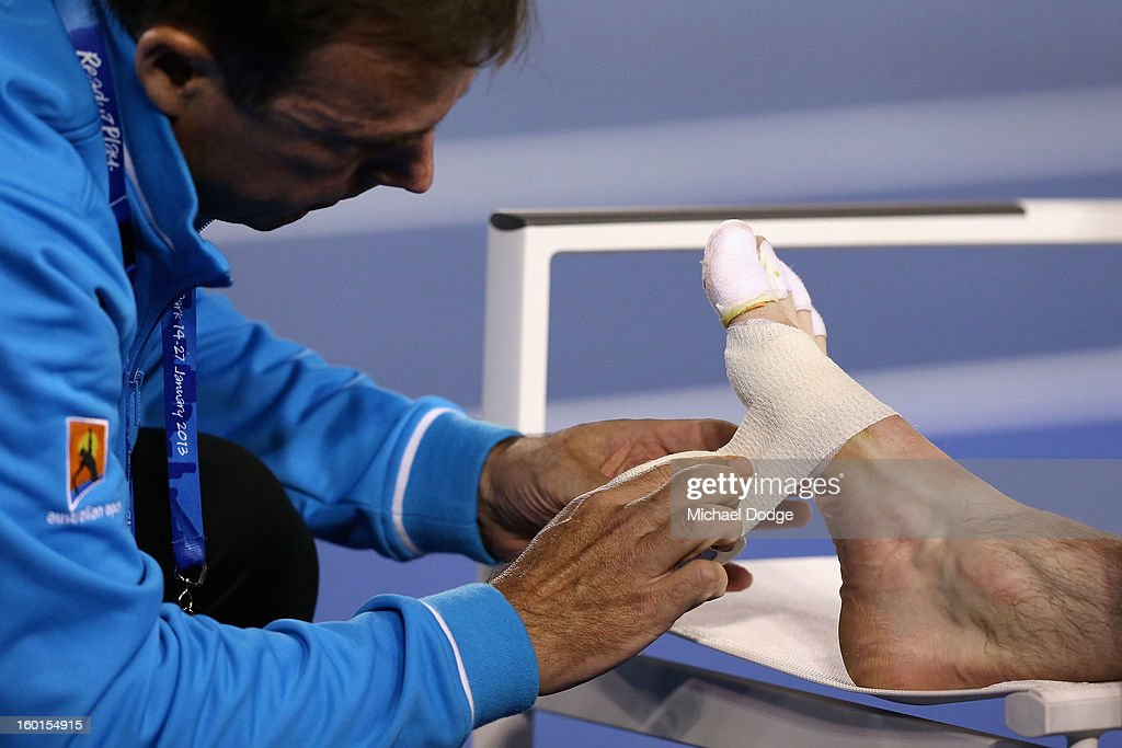 Andy Murray of Great Britain receives medical attention to his foot in his men's final match against Novak Djokovic of Serbia during day fourteen of the 2013 Australian Open at Melbourne Park on January 27, 2013 in Melbourne, Australia.