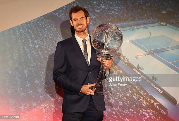 Andy Murray of Great Britain receives the World No1 trophy on stage at Cutty Sark on November 10 2016 in London England