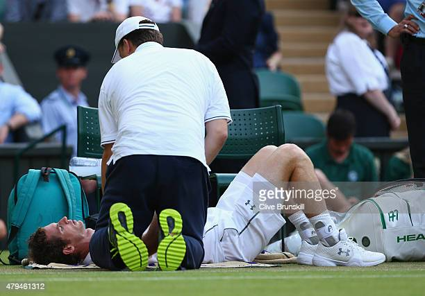 Andy Murray of Great Britain receives treatment to an injury in his Mens Singles Third Round match against Andreas Seppi during day six of the...