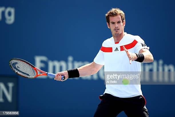 Andy Murray of Great Britain returns a forehand during his men's singles quarterfinal match against Stanislas Wawrinka of Switzerland on Day Eleven...