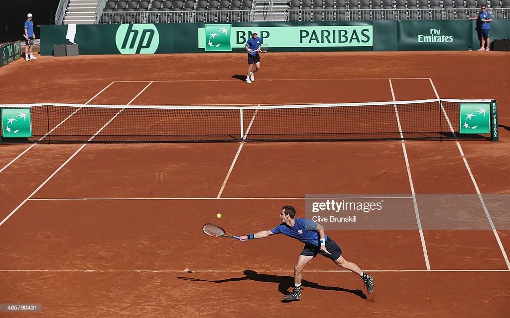 Andy Murray of Great Britain returns a serve from <a gi-track='captionPersonalityLinkClicked' href=/galleries/search?phrase=Kyle+Edmund&family=editorial&specificpeople=7070090 ng-click='$event.stopPropagation()'>Kyle Edmund</a> during a practice session prior to the Davis Cup World Group first round between the U.S. and Great Britain at PETCO Park on January 29, 2014 in San Diego, California.