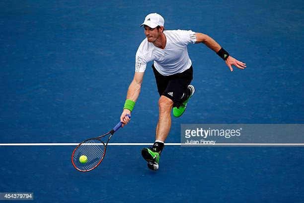 Andy Murray of Great Britain returns a shot against Andrey Kuznetsov of Russia during their men's singles third round match on Day Six of the 2014 US...