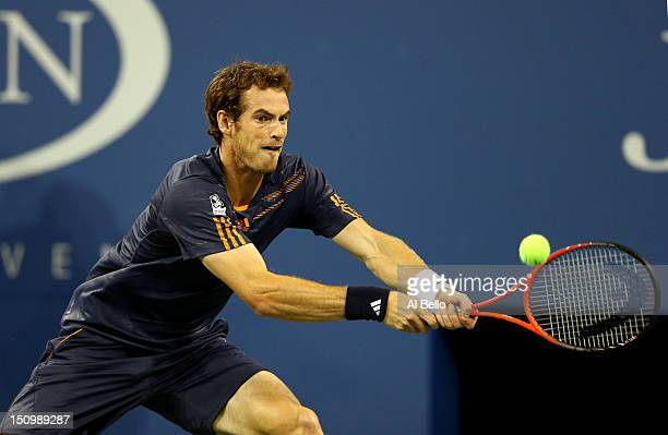 Andy Murray of Great Britain returns a shot against Ivan Dodig of Croatia during their men's singles second round match on Day Three of the 2012 US...