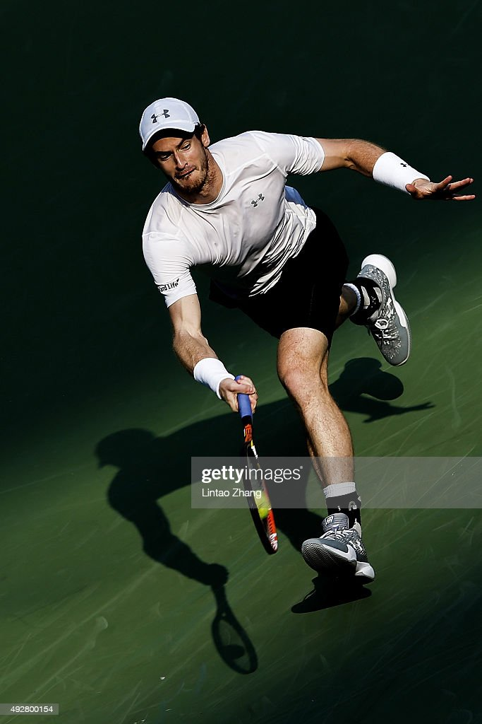 Andy Murray of Great Britain returns a shot against John Isner of the United States during the men's singles third round match on day 5 of Shanghai Rolex Masters at Qi Zhong Tennis Centre on October 15, 2015 in Shanghai, China.