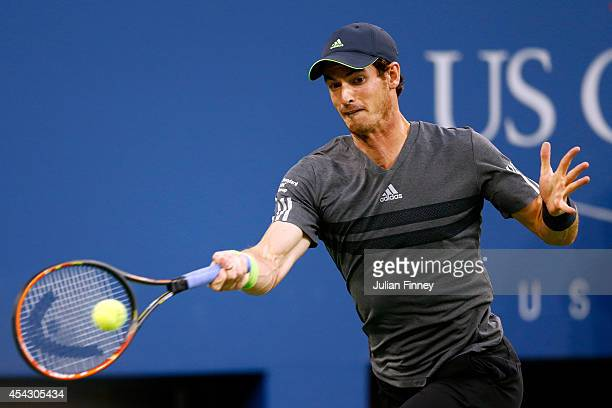 Andy Murray of Great Britain returns a shot against Matthias Bachinger of Germany on Day Four of the 2014 US Open at the USTA Billie Jean King...