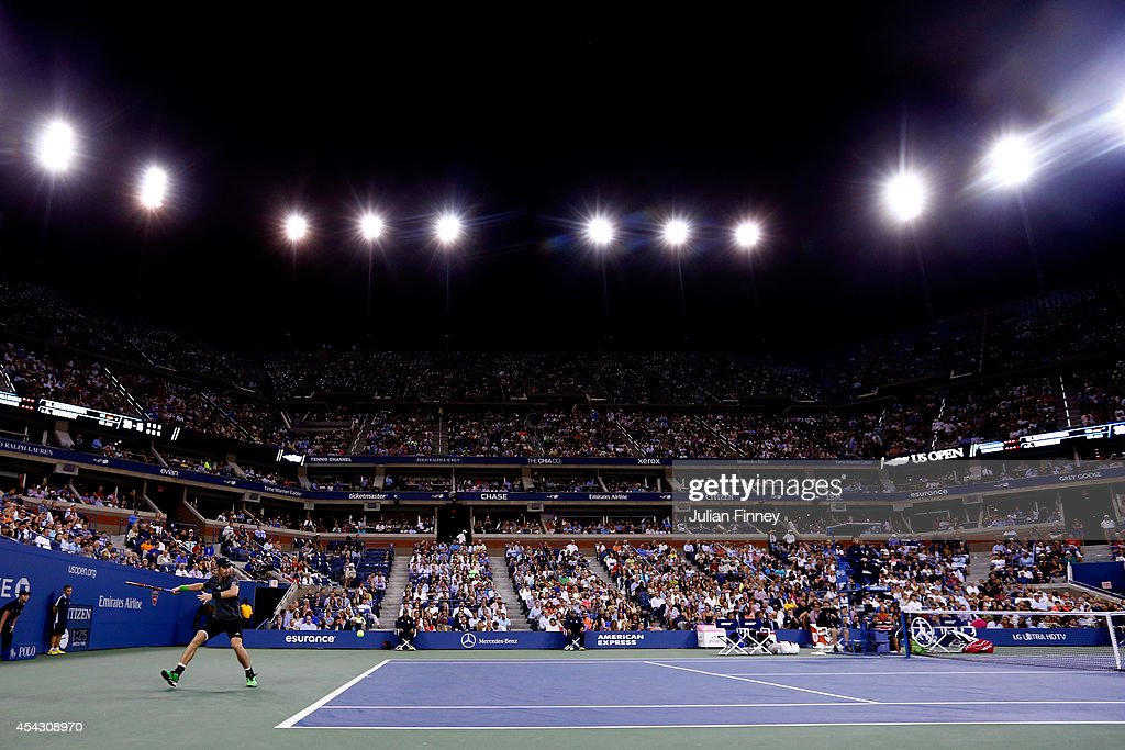 Andy Murray of Great Britain returns a shot against Matthias Bachinger of Germany on Day Four of the 2014 US Open at the USTA Billie Jean King National Tennis Center on August 28, 2014 in the Flushing neighborhood of the Queens borough of New York City.