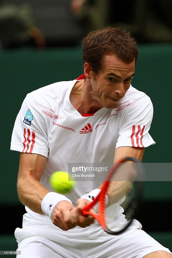 Andy Murray of Great Britain returns a shot during his Gentlemen's Singles first round match against Nikolay Davydenko of Russia on day two of the Wimbledon Lawn Tennis Championships at the All England Lawn Tennis and Croquet Club on June 26, 2012 in London, England.
