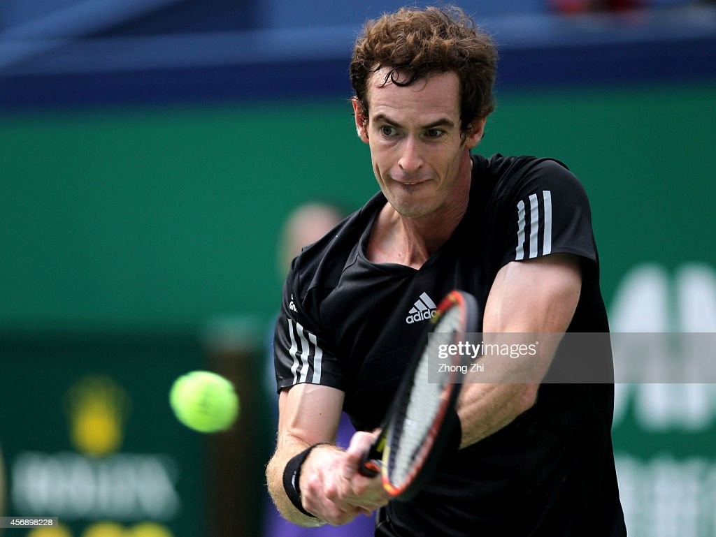 Andy Murray of Great Britain returns a shot during his match against David Ferrer of Spain during the day 5 of the Shanghai Rolex Masters at the Qi Zhong Tennis Center on October 9, 2014 in Shanghai, China.