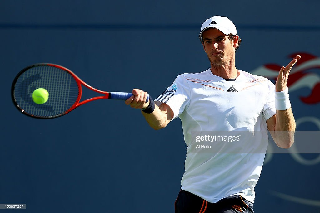 <a gi-track='captionPersonalityLinkClicked' href=/galleries/search?phrase=Andy+Murray+-+Tennis+Player&family=editorial&specificpeople=200668 ng-click='$event.stopPropagation()'>Andy Murray</a> of Great Britain returns a shot during his men's singles first round match against Alex Bogomolov Jr. of Russia on Day One of the 2012 US Open at USTA Billie Jean King National Tennis Center on August 27, 2012 in the Flushing neigborhood of the Queens borough of New York City.