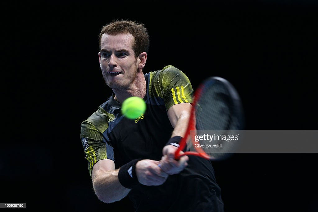 <a gi-track='captionPersonalityLinkClicked' href=/galleries/search?phrase=Andy+Murray+-+Tennis+Player&family=editorial&specificpeople=200668 ng-click='$event.stopPropagation()'>Andy Murray</a> of Great Britain returns a shot during his men's singles match against Jo-Wilfried Tsonga of France on day five of the ATP World Tour Finals at O2 Arena on November 9, 2012 in London, England.