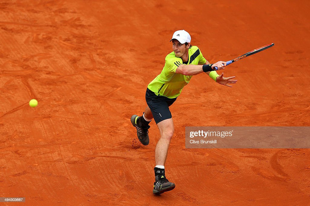 Andy Murray of Great Britain returns a shot during his men's singles match against Marinko Matosevic of Australia on day five of the French Open at Roland Garros on May 29, 2014 in Paris, France.