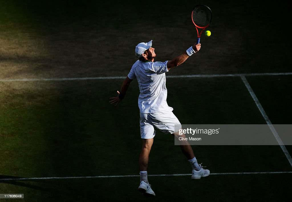 Andy Murray of Great Britain returns a shot during his quarterfinal round match against Feliciano Lopez of Spain on Day Nine of the Wimbledon Lawn Tennis Championships at the All England Lawn Tennis and Croquet Club on June 29, 2011 in London, England.